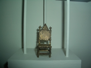Miniature gold chair, from Africa, I think.